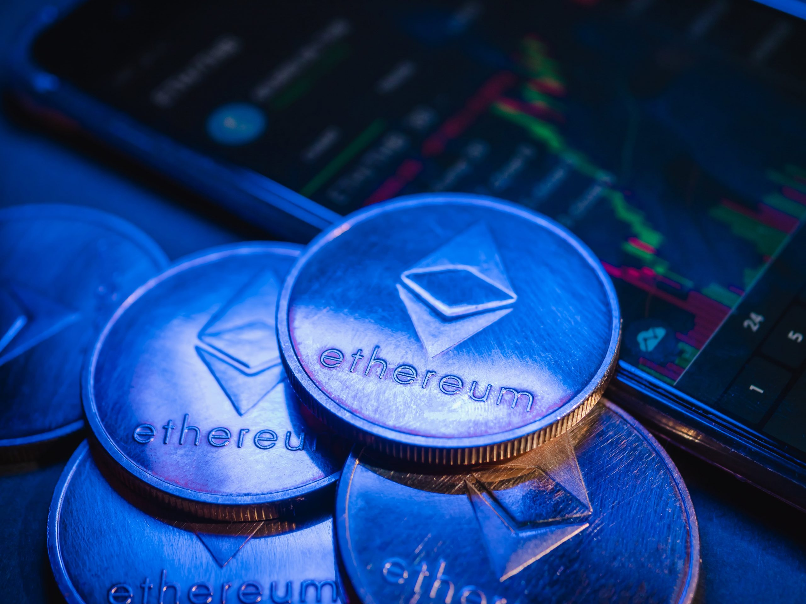 ethereum-coins-with-stock-graph-background-digital-KNXXPEL-min